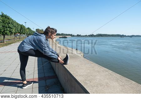 Young Beautiful Happy Sporty Fitness Woman Standing Outdoor Stretching Her Muscles Preparing For Jog