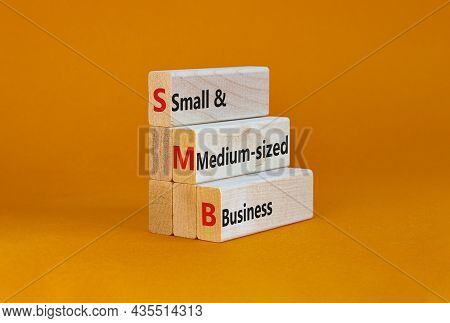Smb Small And Medium-sized Business Symbol. Words Smb Small And Medium-sized Business On Blocks On A