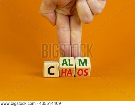 Stop Chaos, Time To Calm. The Words 'chaos' And 'calm' On Wooden Cubes. Beautiful Orange Background,