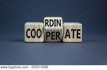 Coordinate And Cooperate Symbol. Turned Wooden Cubes And Changed The Word 'cooperate' To 'coordinate