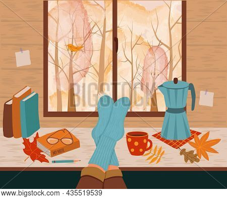 Feet In Knitted Socks Are Lying On The Table. Outside The Window Is An Autumn Landscape. Coffee Make