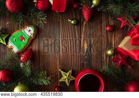 Hot Christmas Tea With Gingerbread Cookie On Wooden Table. Top View. New Year And Christmas Celebrat