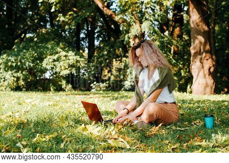 Young Woman Freelancer With Laptop And Disposable Cup Of Latte Working Online, Student Girl Typing M
