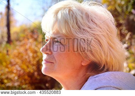Day Dreaming Senior  Woman Outdoors. Confident Senior Woman Looking Thoughtful During  Walking Count