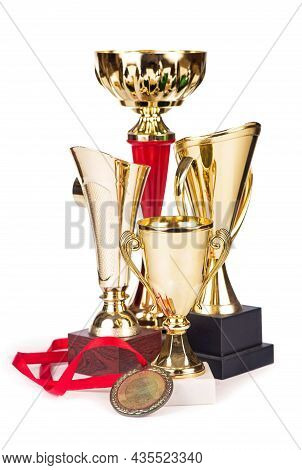 Trophies, Cups, Medals Isolated On White. The Trophy Is A Tangible And Lasting Reminder Of A Specifi