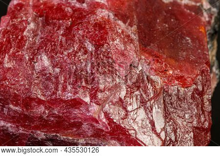 Macro Mineral Rhodonite Stone On A Black Background Close-up