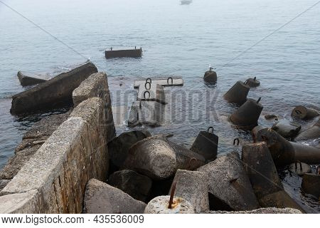 Protective Concrete Blocks Designed To Protect The Coastline From Storms.