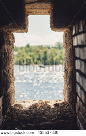 Observation Window In The Brick Wall Of The Fortress For Firing A Gun With