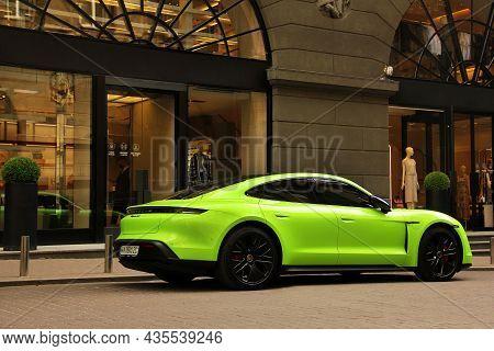 Kiev, Ukraine - June 19, 2021: Matte Porsche Taycan Turbo S Lime Color In The City