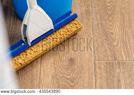Cleaning Tools For House Cleaning On Wooden Floor