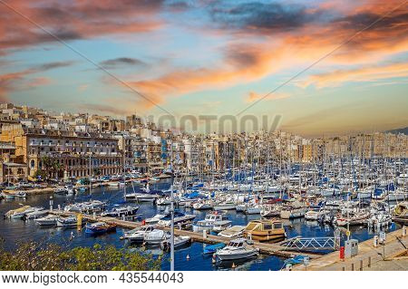 Valletta, Malta - March 25, 2021: Yachts And Boats Moored In The Harbor Of Dockyard Creek In Front O