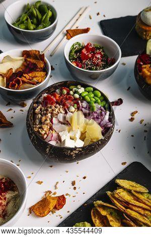 Variety Of Bowls Of Typical Hawaiian Food.