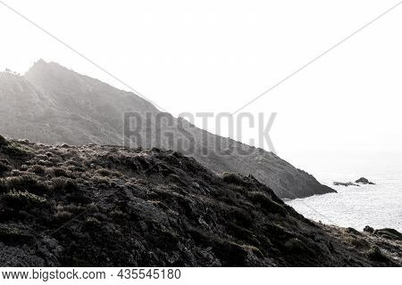 View Of A Rocky Coastline Landscape During Sunset