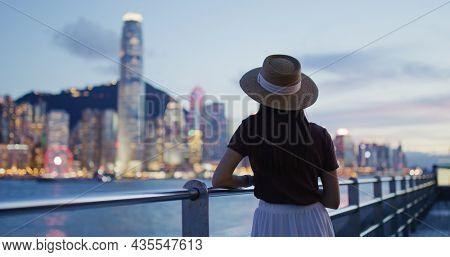 Woman traveler visit beautiful Hong Kong night view