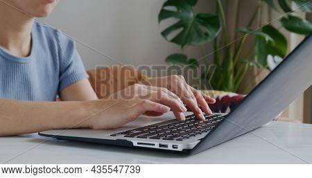 Type on the laptop keyboard