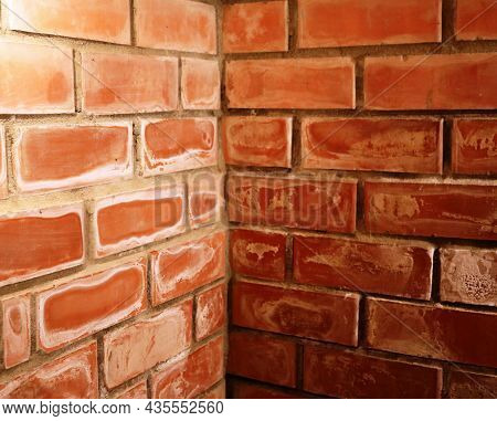 Brick Corner In The Basement As An Empty Background, The Connection Of Two Brick Walls In The Room W