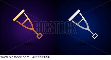 Gold And Silver Crutch Or Crutches Icon Isolated On Black Background. Equipment For Rehabilitation O
