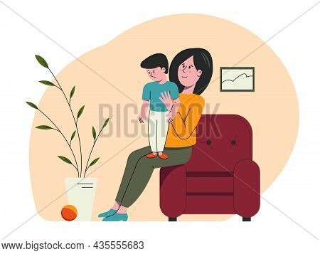 Mom Plays With The Child At Home. A Woman Is Sitting With A Little Boy On Her Lap. Leisure Of The Fa