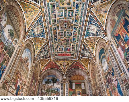 Siena, Italy - August 15 2021: Piccolomini Library Vault Ceiling Interior In Siena Cathedral With Fr