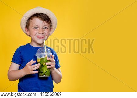 Summer Refreshment. Cold Beverage. Little Boy With Plastic Cup Of Fresh Lemonade