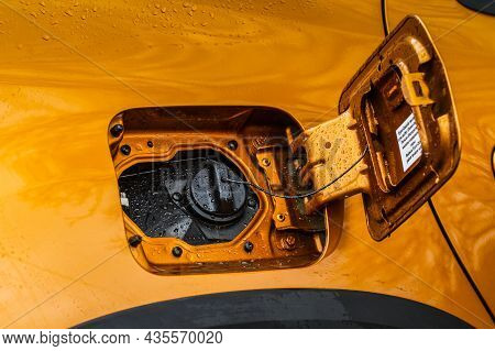 Exterior Of Car With Fuel Filler Door Open. Opened Fuel Tank Cap Of A Car For Filling Gasoline Or Di