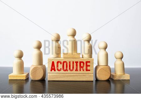 Word Acquire On Wooden Block, Business Concept