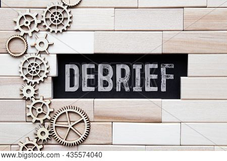 Debrief Word In A Dictionary. Debrief Concept.