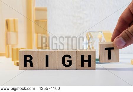 Letter Block In Word Right On Wood Background.