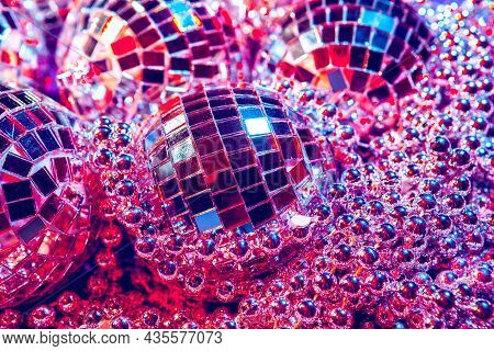 Shiny Small Disco Balls Sparkling In A Beautiful Purple Light. Disco Party Concept