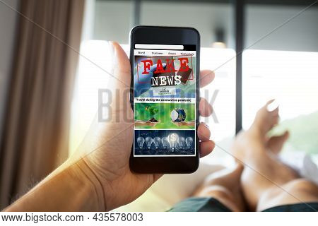 Man Reading Fake News Or Articles About Covid-19 In A Smartphone Screen Application. Mockup App Webs