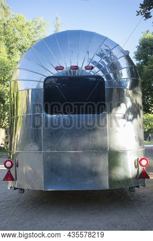 Rounded Metal American Caravan Used As Mobile Catering Vehicle. Rear View