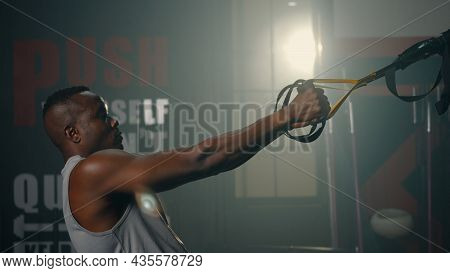 Black Muscular Man During Exercise Training Workout Bodyweight With Suspension Straps Trx Pull Ups T