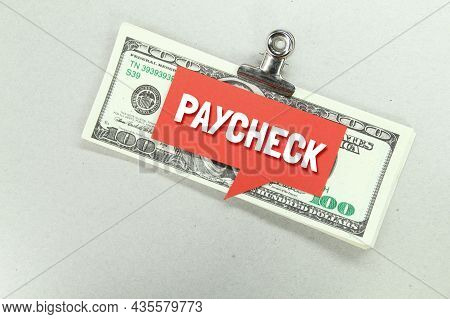Conversation Boxes And Banknotes Are Stuffed With The Word Paycheck