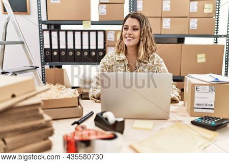 Young hispanic woman smiling confident working at office