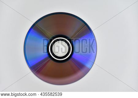 Used Laser Cd Or Dvd On The Surface Of The White Background