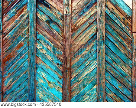 Background Of Brown Wooden Fence Made Of Planks. The Texture Of An Old Rustic Wooden Fence Made Back