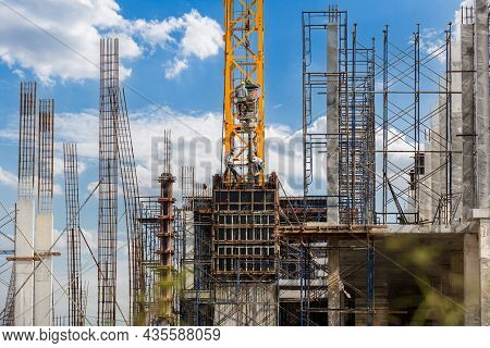 Working At Height Equipment With Bucket Liquid Concrete Container. Construction Worker Working On A