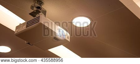 Overhead Digital Projector Mounted On The Ceiling Of The Boardroom Or Meeting Room Or Seminar Techno