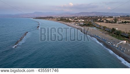 Aerial View, Drone Photograph Of The Coastline Of Pano Pyrgos Village In Cyprus.