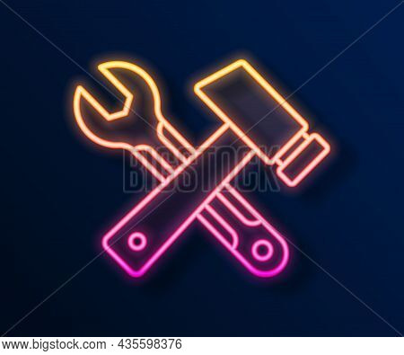 Glowing Neon Line Crossed Hammer And Wrench Spanner Icon Isolated On Black Background. Hardware Tool