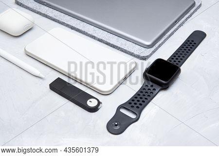 Flat Lay Of Modern Essential Work Tools Of A Designer: Smartphone, Smartwatch, Digital Tablet, Stylu