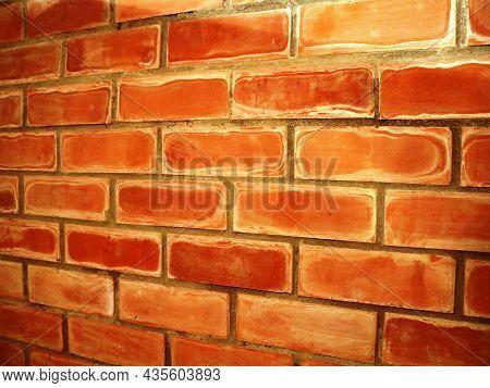 Terracotta Brick Wall In A Corner Perspective, Textured Brick In Interior Masonry At An Angle, Brick
