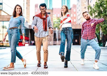 Multicultural Friends Walking At City Center Acting Funny Moves - Happy Guys And Girls Having Fun By