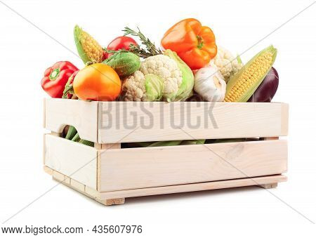 Various Fresh Vegetables In A Wooden Box Isolated On A White Background. Tomatoes, Paprika, Cauliflo