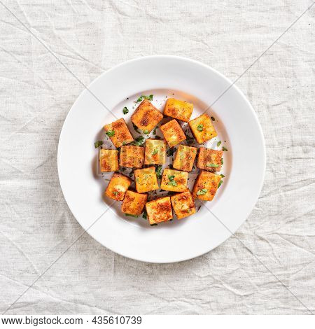 Pan Fried Paneer. Indian Roasted Cottage Cheese Bites On Plate Over Light Background. Top View, Flat