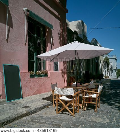 Empty Table In An Outdoor Restaurant In The Old Town In Colonia Uruguay