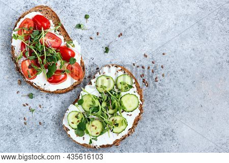 Sandwich Bread With Prosciutto, Salami, Salad, Vegetables, Lettuce, Tomato, Onion And Mustard On A F