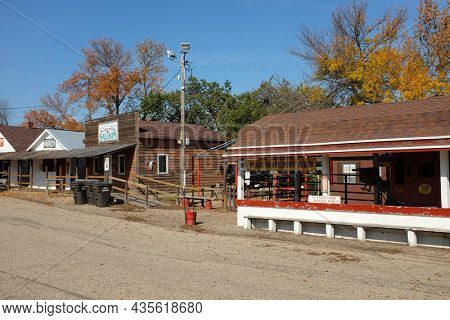 JAMESTOWN, NORTH DAKOTA - 3 OCT 2021: Saloon and Stage Coach Ride along Louis L'Amour Lane in Frontier Town.