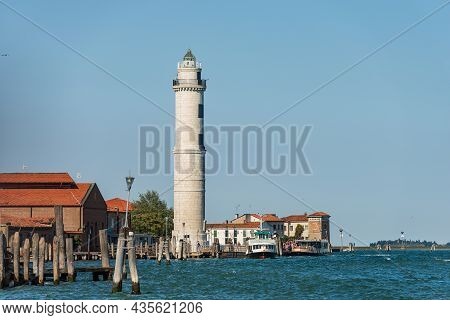 The Ancient Lighthouse Of The Island Of Murano, Famous For The Production Of Artistic Glass, With Th