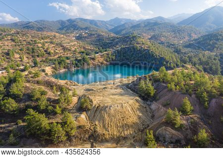 Abandoned Pyrite Mine In Xyliatos, Cyprus. Lake In Open Mine Pit And Waste Heaps Over Mountains Land